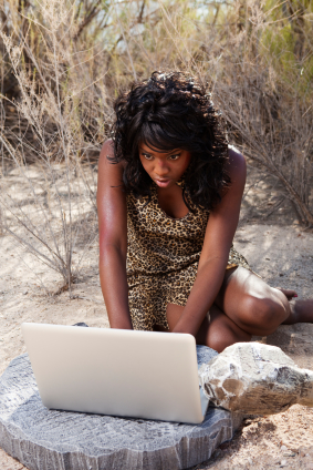 cave woman with laptop cavewoman